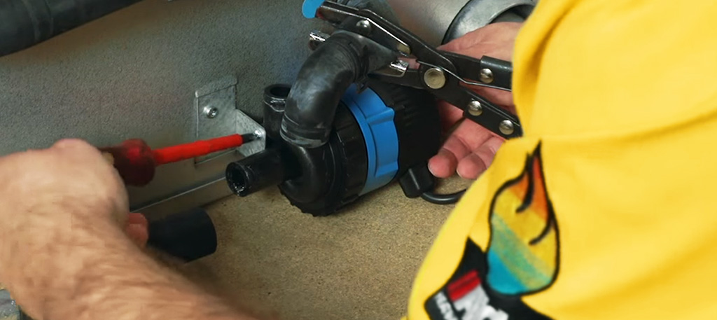 Inline pump being installed